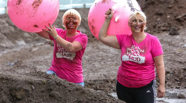 Pink power: Rosie Adamson and Andrea Halls test out the space hoppers for the Pretty Muddy event