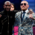 Cashing in: Floyd Mayweather and Conor McGregor after fight
