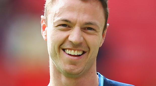 In demand: Leicester and Man City both want Jonny Evans