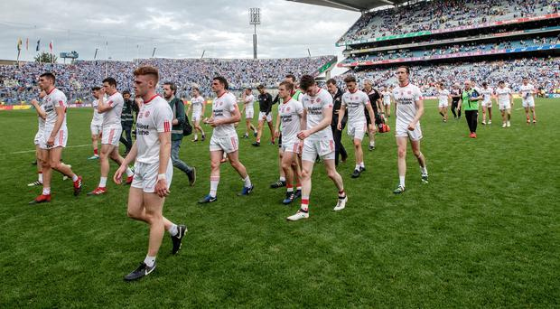Down and out: Tyrone's players trudge off the Croke Park pitch after their hammering against Dublin. Photo: James Crombie/INPHO