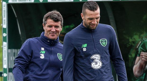 Smile like you mean it: assistant manager Roy Keane and Shane Duffy during Republic of Ireland training yesterday. Photo: INPHO/Gary Carr/INPHO