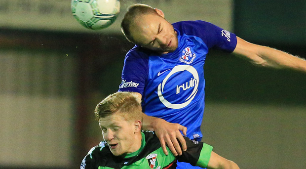 bite bite: Glentoran's Dwayne Nelson and Loughgall's Jordan Baker. Photo: David Maginnis/Pacemaker