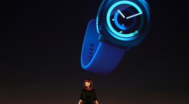 Samsung employee Kate Beaumont presents products from the company's new wearables collection, at a Samsung press conference in Berlin. Photo: Sean Gallup/Getty Images