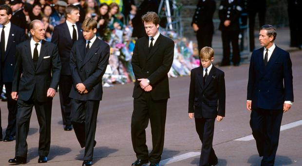 The Duke of Edinburgh, Prince William, Earl Spencer, Prince Harry and Prince Charles walk behind Diana's coffin