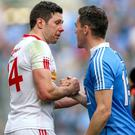 Legend: Sean Cavanagh (left), at the end of his glittering Tyrone career at Croke Park on Sunday, congratulates Dublin's Paddy Andrews. Photo: Gary Carr/INPHO