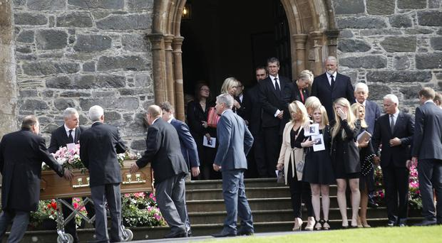 Family and Friends walk behind the coffin of Lorraine Hall following a funeral at St Malachy's Parish Church in Hillsborough. Pic by Peter Morrison
