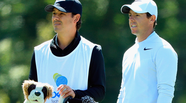 Up and down: Rory McIlroy and his caddie Harry Diamond focus on the second yesterday