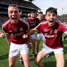 Shout out: Mark Gill and Ronan Glennon celebrate Galway's win. Photo: Tommy Dickson/INPHO