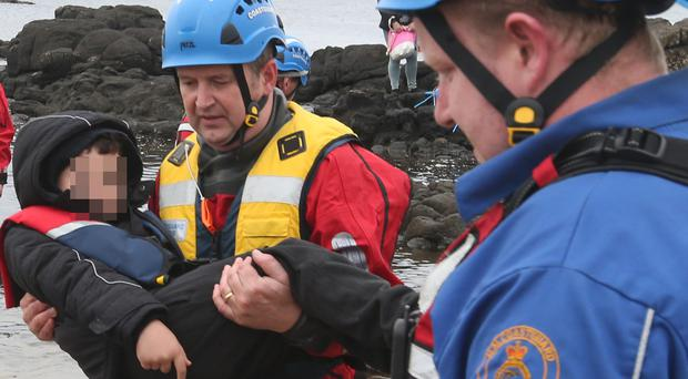 Two adults and four children were rescued by coastguard teams after getting into difficulty on rocks in Portballintrae on Sunday