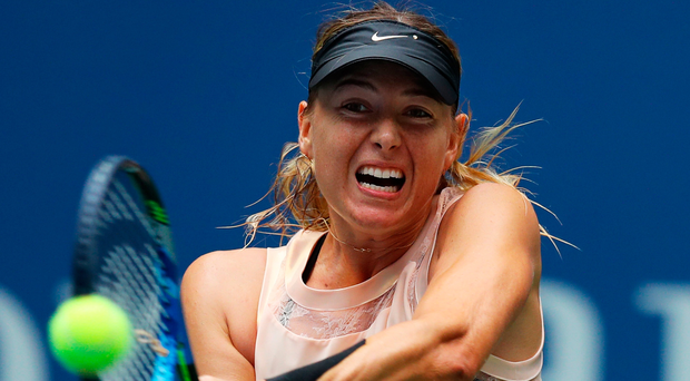 Down and out: Maria Sharapova during her defeat at the US Open. Photo: Richard Heathcote/Getty Images
