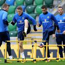 Big hurdle: Steven Davis leads NI training yesterday ahead of the crunch clash with Czech Republic. Photo: William Cherry/Presseye