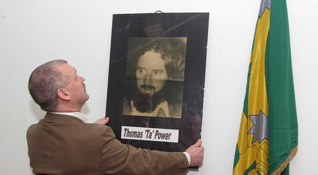 Former INLA man Gerard Murray with a picture of Thomas 'Ta' Power