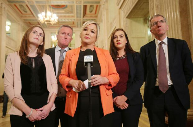 Sinn Fein leader Michelle O'Neill leads some of her party colleagues out to speak to the media in the Great Hall at Parliament Buildings, Stormont.