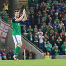 Northern Ireland's Chris Brunt applauds the fans after this evening's game at the National Stadium, Belfast.