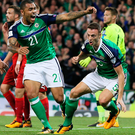 Net busters: Josh Magennis and goalscorer Jonny Evans get the party started as Northern Ireland sweep aside Czech Republic last night