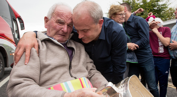 Big moment: Galway boss Micheal Donoghue shows Liam McCarthy Cup to his father Miko Donoghue in Ballinasloe