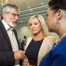 Sinn Fein president Gerry Adams, the party's northern leader Michelle O'Neill and deputy party leader Mary Lou McDonald.