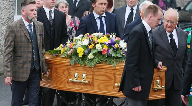 Funeral of former Portadown Times journalist Victor Gordon, who died at home last week aged 75, at Armagh Road Presbyterian Church in Portadown. Mr Gordon's coffin is carried from the church by friends and family. Picture by Jonathan Porter/PressEye.com