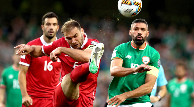No way through: Republic of Ireland ace Jonathan Walters is beaten to the ball by Branislav Ivanovic of Serbia. Photo: Ryan Byrne/INPHO