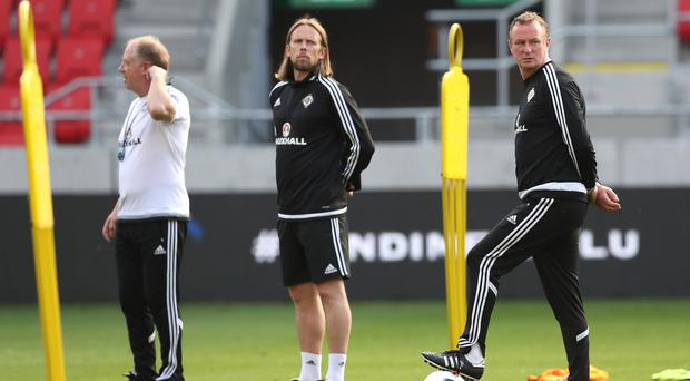 Looking on: Jimmy Nicholl, Austin MacPhee and Michael O'Neill observe the Northern Ireland players. Photo: William Cherry/Presseye
