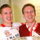Brothers Cormac and Donal McAnallen celebrate Tyrone's All Ireland win