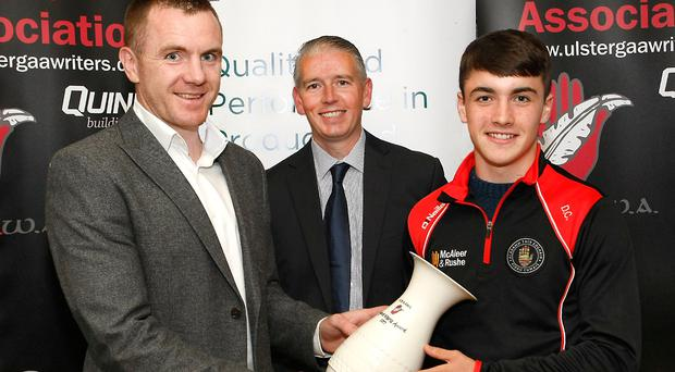 Big bonus: Darragh Canavan with Martin McGrath (Quinn Building Products) and John Martin (Ulster GAA Writers)