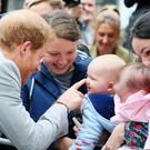 Prince Harry meets Emma Mason (second left) and her seven month old son Henry Mason in St Anne's Square, Belfast, during a visit to Northern Ireland. PRESS ASSOCIATION Photo. Picture date: Thursday September 7, 2017. See PA story ROYAL Harry. Photo credit should read: Brian Lawless/PA Wire