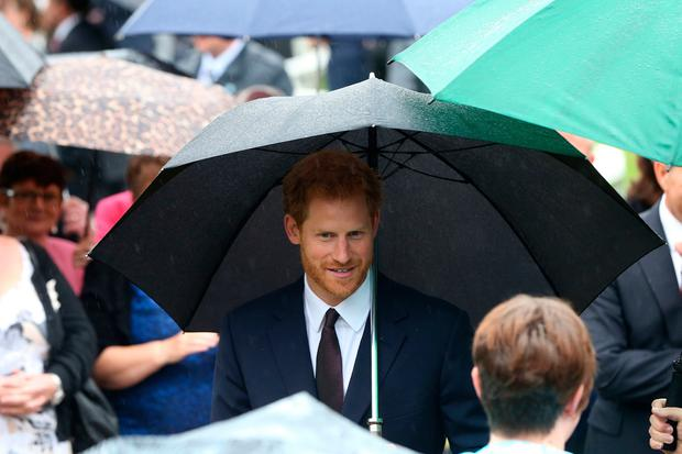 Prince Harry meets guests at a garden party at Hillsborough Castle during a visit to Northern Ireland. PRESS ASSOCIATION Photo.
