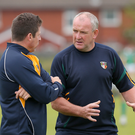 Looking up: Frank Fitzsimons (right, with Gearoid Adams) believes Antrim can gain promotion to Division Three next season