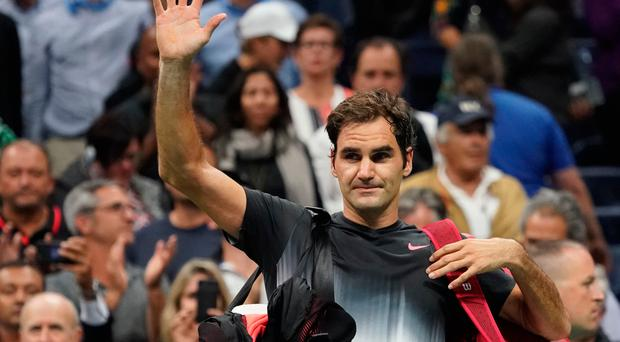 Roger Federer waves to the crowd after losing to Juan Martin del Potro