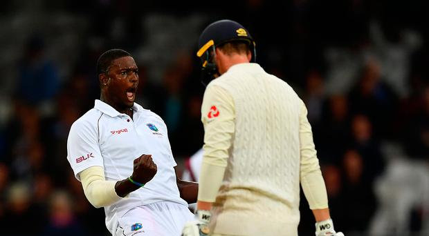 On target: Jason Holder of the West Indies celebrates taking the wicket of Tom Westley at Lord's yesterday