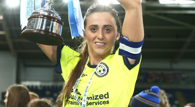 Goal ace: Sion Swifts skipper Kendra McMullen lifts the cup