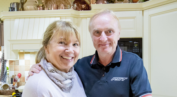 All smiles: Brian Reid at home with long-term partner Lynn in Banbridge. Photo: Kevin Scott/Belfast Telegraph