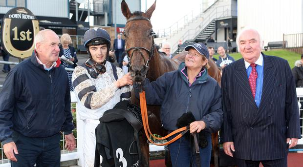 Winner alright: Our Rachael and jockey Oisin Orr after winning the West Coast Cooler Original Apprentice Handicap at Down Royal last night, along with trainer Tony Martin and owner Donal Houlihan. Photo: Freddie Parkinson/Presseye
