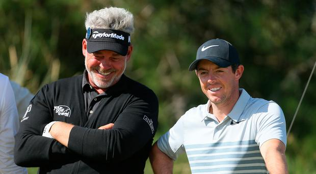 Happier times: Darren Clarke believes Rory McIlroy will soon be playing with a smile on his face again