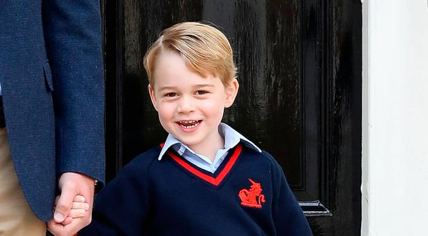 Family matters: William with Prince George on his first day of school