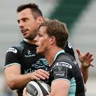 Andrew Trimble celebrates with Tommy Bowe during victory in Treviso