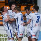 Control: Darren McCauley is congratulated after making it 2-0 on Saturday