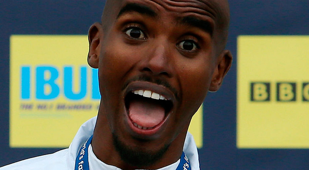 Mo Farah celebrates winning the men's elite race during the Great North Run