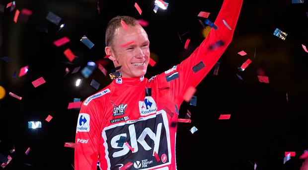 Chris Froome celebrates on the podium after winning the Vuelta a Espana race