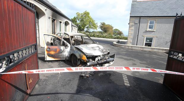 The scene on the Brustin Brae Road outside Larne in Co. Antrim where shots were fired at a property along with a vehicle being set on fire in the early hours of Monday morning. Picture by Jonathan Porter/PressEye.com