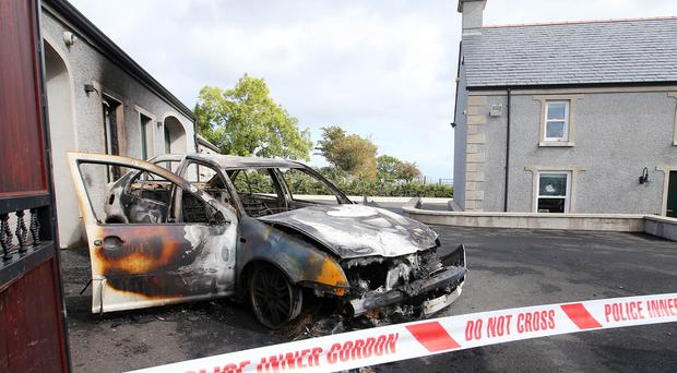 Press Eye Belfast - Northern Ireland 11th September 2017 The scene on the Brustin Brae Road outside Larne in Co. Antrim where shots were fired at a property along with a vehicle being set on fire in the early hours of Monday morning. Picture by Jonathan Porter/PressEye.com