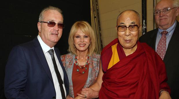 His Holiness the 14th Dalai Lama with Richard Moore, director, Children in Crossfire, and actress Johanna Lumley (Lorcan Doherty / Presseye)