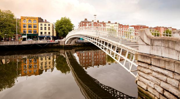 A famous tourist attraction in Dublin, Ireland, Ha'penny Bridge.