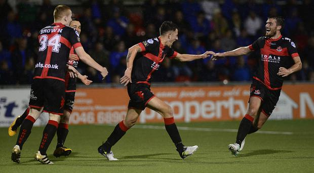 Crusaders' Jordan Forsythe celebrates opening the scoring at Seaview.