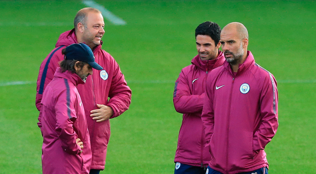 Taking it in: Pep Guardiola and his backroom team during a City training session yesterday. Photo: Lindsey Parnaby/Getty Images
