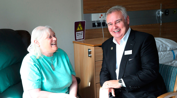 Eamonn Holmes chats with patient Ursula Burns during his visit to the NI Hospice in North Belfast yesterday