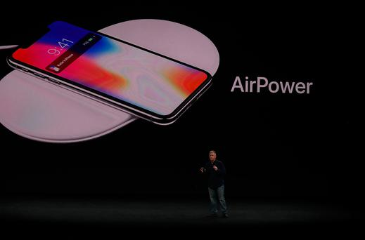 CUPERTINO, CA - SEPTEMBER 12: Apple senior vice president of worldwide marketing Phil Schiller introduces AirPower during an Apple special event at the Steve Jobs Theatre on the Apple Park campus on September 12, 2017 in Cupertino, California. Apple held their first special event at the new Apple Park campus where they announced the new iPhone 8, iPhone X and the Apple Watch Series 3. (Photo by Justin Sullivan/Getty Images)