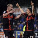 Singing in the rain: Paul Heatley is congratulated by Jordan Owens after his stunning strike. Photo: Stephen Hamilton/INPHO