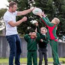 Full stretch: Irish international and Ulster Rugby star Tommy Bowe with (L-R) Patrick Bergin, Ben Donlon and Emma Rotaru of Our Lady's NS Clonskeagh, Dublin. Photo: Morgan Treacy/INPHO